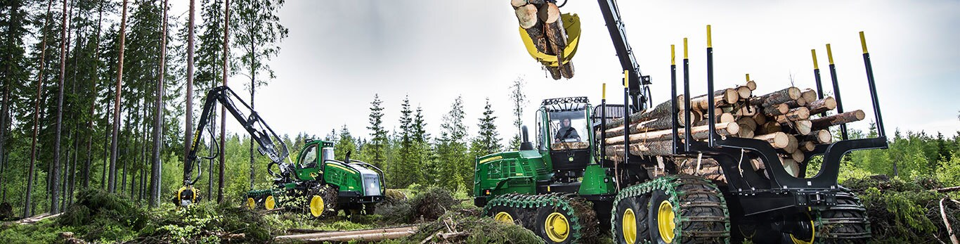 John Deere forwarder and harvester at work in a forest